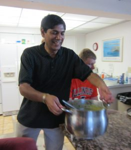 Mithilesh with pot of food